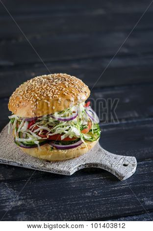 Delicious Veggie Burger - Cabbage, Tomato, Cucumber, Lettuce, And A Homemade Bun For Burgers, On A D