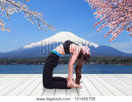 Woman Doing Yoga Exercise On Wood Floor With Mt Fuji Background