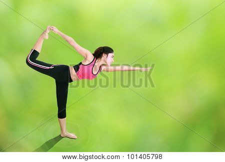 Woman Doing Yoga Exercise With Natural Blur Background