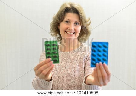 Adult Woman Holding  Blister Pack Of A Pills