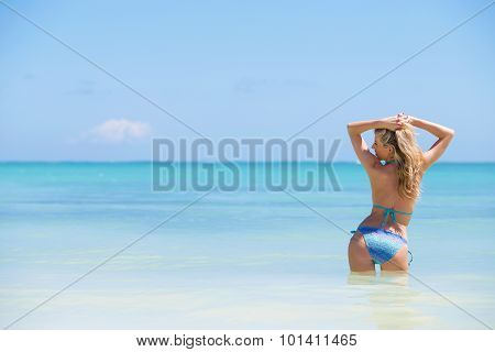 Woman in bikini posing in the ocean