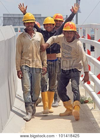 builders are rejoicing to someone on the street in Johor Bahru
