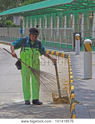 street cleaner is doing his work in Johor Bahru