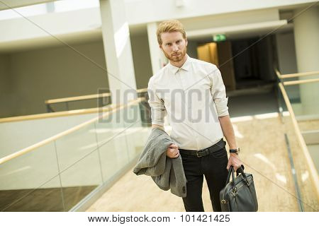 Young Businessman In The Hallway