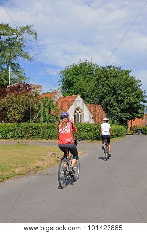 Cycling through Turville village.