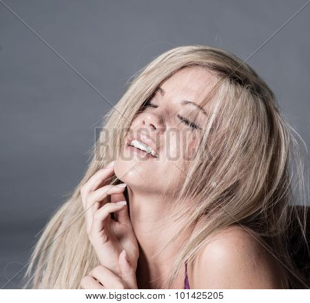 woman with look of ecstasy on face