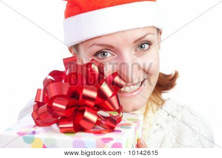 Happy Smiling Woman In Christmas Hat With Gift