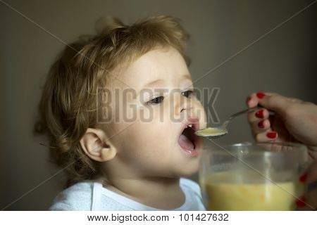 Cute Child Boy Eating Soup