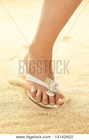 Woman foot on sand