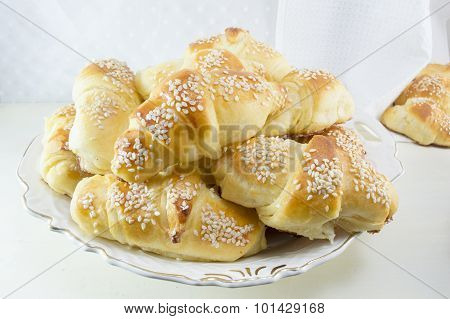 Homemade Pastry In A Plate On White Wooden Table