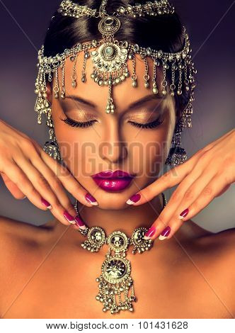 Beautiful Indian woman portrait with jewelry . elegant Indian girl with  traditional Indian jewelry