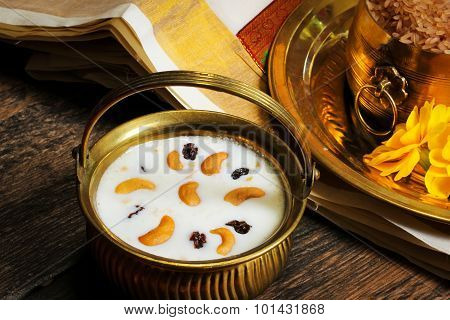 Pudding - Pal Payasam Kheer Indian food garnished with cashew and raisin Side View