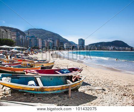 RIO DE JANEIRO, BRAZIL - APRIL 24, 2015: Row of colorful boats on April 24, 2015 at Copacabana Beach, Rio de Janeiro. Brazil.
