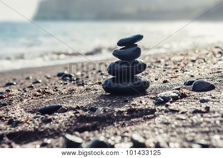Stones Pyramid On The Beach
