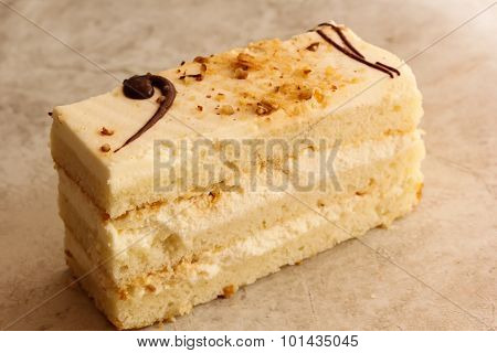 White layered cake with whipped cream