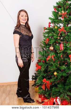 Woman standing nearby Christmas tree