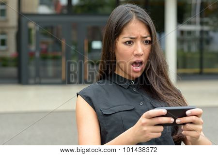 Young Woman Reacting In Horror To An Sms