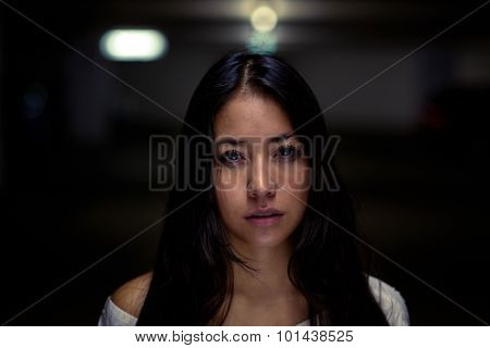Serious Young Woman Against A Night Background