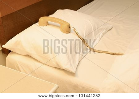 Old Telephone On The Bed In Hotel