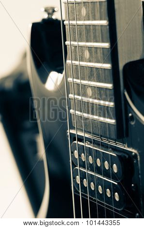 Detail of six-string electric guitar closeup selective focus. Processed with vintage style.