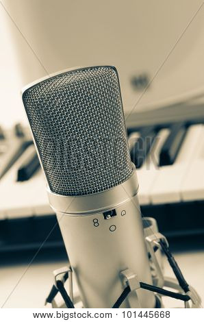 Microphone in recording studio on a white background. Vintage style