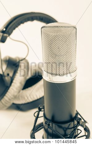 Microphone in a recording studio on a white background. Vintage style.