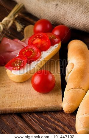 Fresh Red Cherry Tomato Between Rolls And Baguette