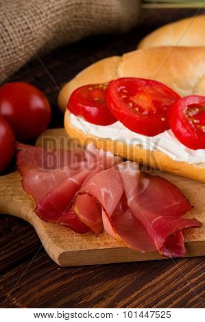 Slice Of Smoked Ham In Front Of Baguette With Cottage