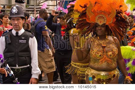 Carnival goer & policeman at Notting Hill Carnival