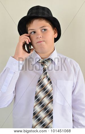 Teen Boy Talking On Cell Phone At  Light Background