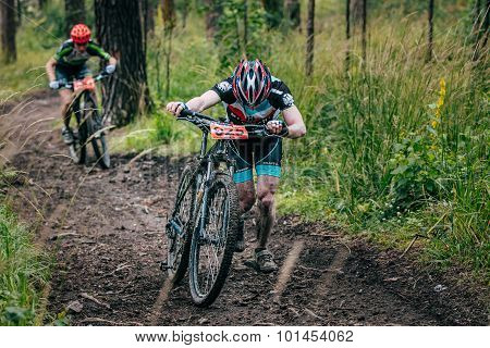 two mountainbiker in a uphill race