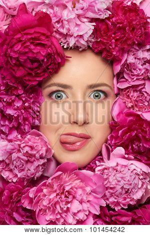 Woman face in peony flowers
