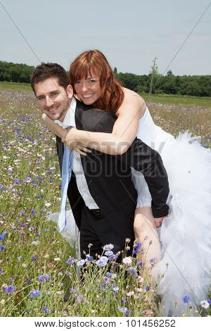 Newly Lovely Wedding Couple Happy In The Country Piggy Back