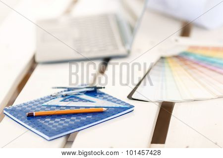 Stationary lying on the table.