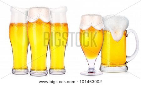 Frosty glasses of light beer isolated