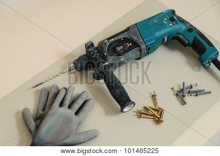 Drilling Machine, Dowels And Gloves
