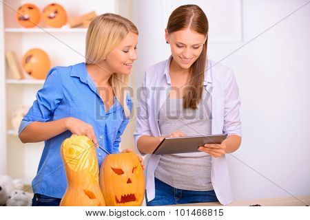 Cheerful girls holding laptop