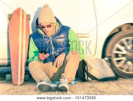 Hipster Man Model With Smartphone Resting At Car Trip With Winter Fashion Clothes