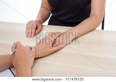 Skilled young doctor is supporting her patient