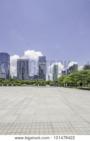 empty city square with  skycrapers and trees