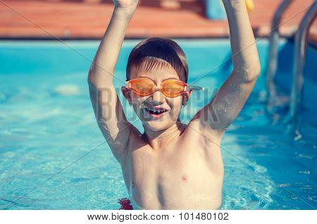 Little Boy Hands Up In Pool
