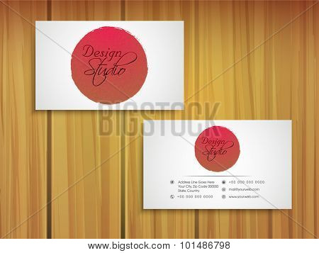 Glossy stylish horizontal business card, name card or visiting card set on wooden background.
