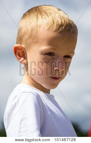 Portrait Of Thoughtful Little Boy Child Outdoor