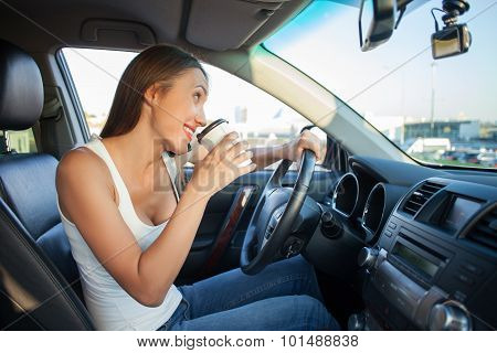 Cheerful young woman is using telephone during her trip