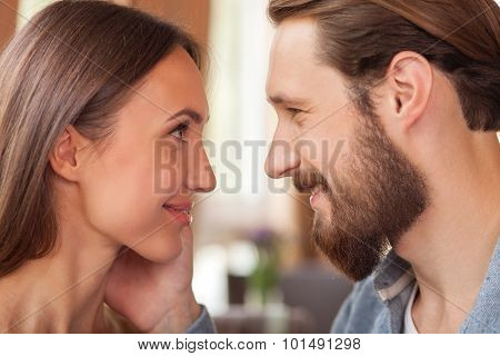 Cheerful man and woman are spending time together