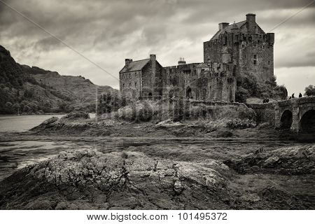 Eilean Donan Castle in black and white at low tide in the Highlands, Scotland