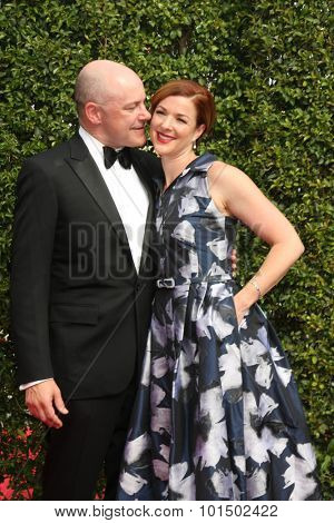 vLOS ANGELES - SEP 12:  Rob Corddry, Sandra Corddry at the Primetime Creative Emmy Awards Arrivals at the Microsoft Theater on September 12, 2015 in Los Angeles, CA