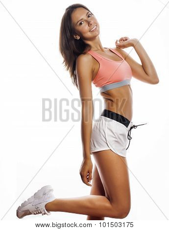 young pretty woman in sports wear isolated on white