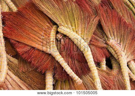 Pile Of Handmade Brooms