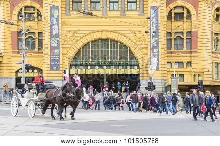Horse-drawn Carriage And Commuters Outside The Flinders Street Station In Melbourne